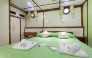 Comfortable large bed cabin with ensuite bathroom with shower and toilet
